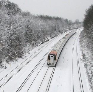 Sutton Guardian: More than 100 rail passengers have been stranded after their train became stuck in snow (stock image)