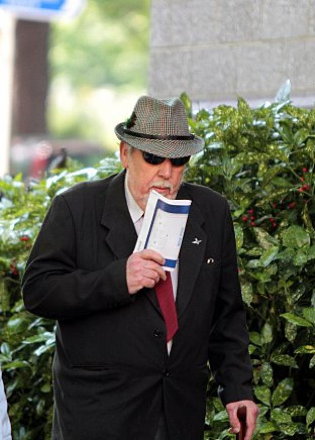 William Lambert arrives at court this week wearing dark glasses and a hat to hide his face