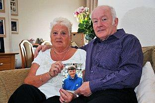 Sutton Guardian: Peter and Christine Boxell with a picture of their son Lee