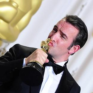 Jean Dujardin with the best actor statuette for The Artist at the 84th Academy Awards