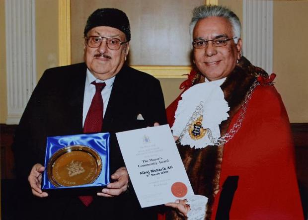 Hajee Mubarik Ali (left) receiving his Mayor's Community award from Councillor Shiraz Mirza