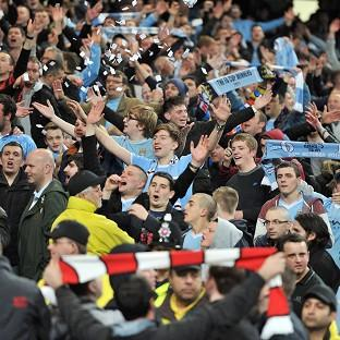 Manchester City fans celebrate beating Manchester United 1-0