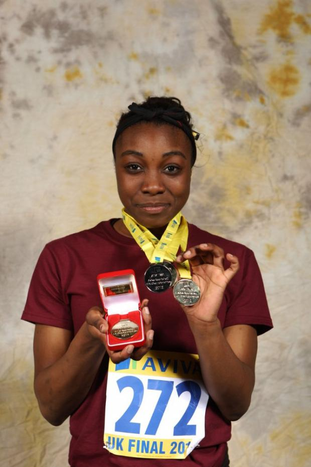 Medal haul: Michella Obijiaku poses with her four Aviva Athletics Academy Sportshall medals