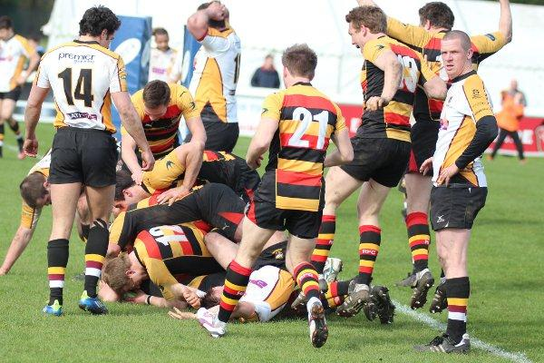 Party time: Richmond players mob Will Warden after he scored the winner in Saturday's clash with Caldy
