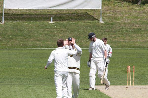 How's that: Dulwich's Tom Saville is bowled out for a duck on Saturday