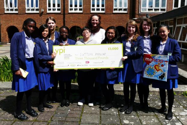 Mencap Community Fundraiser Tracey Hickey with the winning Year 8 team and one of the young adults supported by the charity