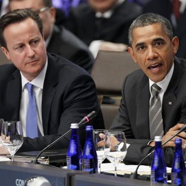 David Cameron with President Obama during the meeting on Afghanistan at the Nato Summit (AP)