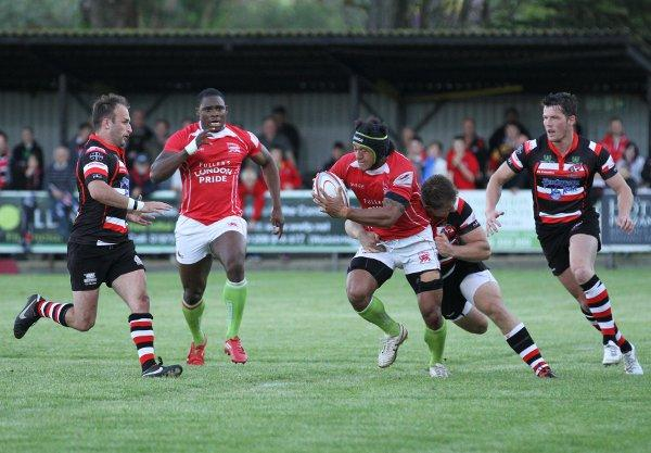 Big lad: London Welsh centre Hudson Tonga'Uiha slips the Cornish Pirates defence as Joe Ajuwa looks on