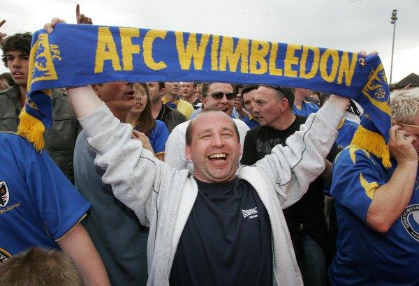 Happy days: An AFC Wimbledon fan celebrates the Ryman Premier play-off win over Staines Town in 2008