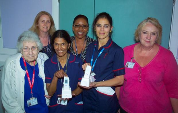 Staff at St Helier Hospital's maternity unit, including Sally Sivas (Back left) receive the new baby jaundice meters from League of Friends Chairman, Val Brundle (far right).