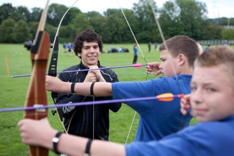 Chris Morley from H & H Archery with school pupils Charlie King, James Penfold