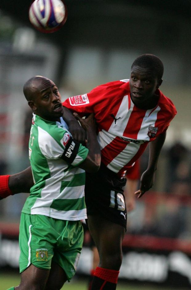 Flying high: Eastleigh's Moses Ademola in action for Brentford