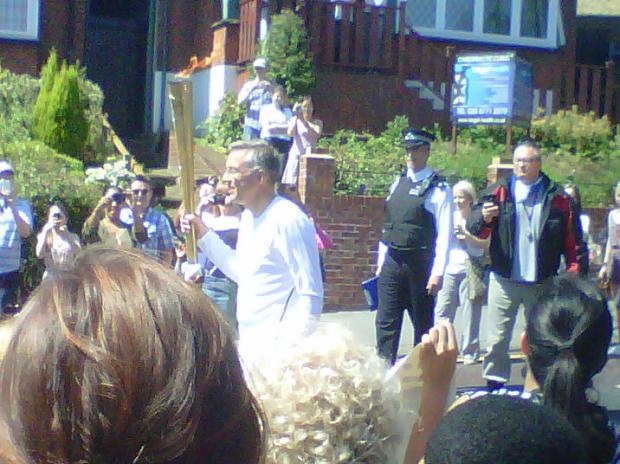 Jonathan Dean with the flame in Croydon