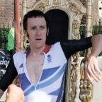 Sutton Guardian: WHAT A HERO: Bradley Wiggins on his throne at Hampton Court Palace after winning his gold medal