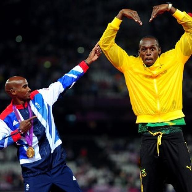 Mo Farah celebrates with Usain Bolt after his victory in the men's 5,000m final