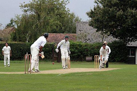Here it comes: Kingstonian's Adil Raza bowls to Sanderstead batsman Dane Robinson during last Saturday's clash 	SP70018