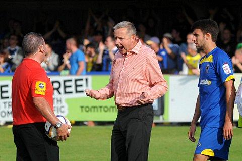 Ref in red: Dons boss Terry Brown rants at the referee after the 2-1 defeat to Rochdale   SP68731
