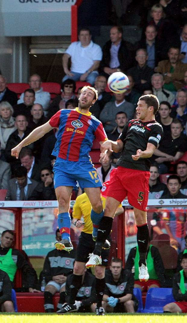 On the head: Crystal Palace's Glen Murray gets up for one against Cardiff on Saturday
