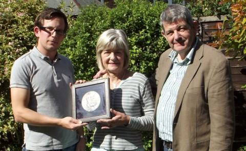 Historian Andrew Arnold returns the plaque to Penny Bastable and Mike Stephenson