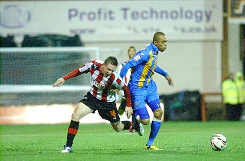 Tussle: Brentford's Adam Forshaw battles with the Shrewsbury Town midfield in Tuesday's stalemate at Griffin Park
