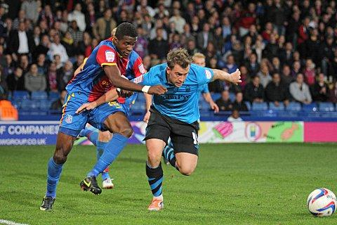 Tricky winger: Wilfried Zaha fights for possession in the 1-1 draw with Nottingham Forest     SP70344