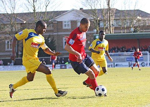 Back: Joel Ledgister in action for Hampton last season against one of his former clubs Woking