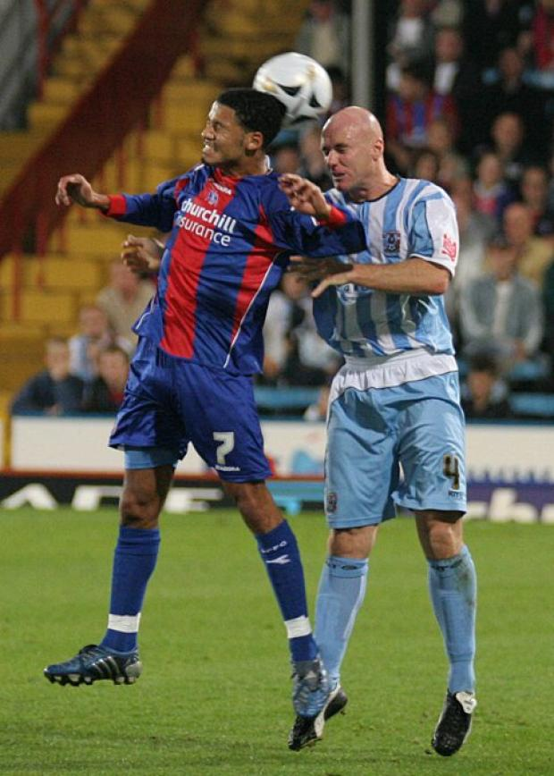 Unconfirmed: Robert Page (in action for Coventry City) has not been unveiled as the new Dons manager