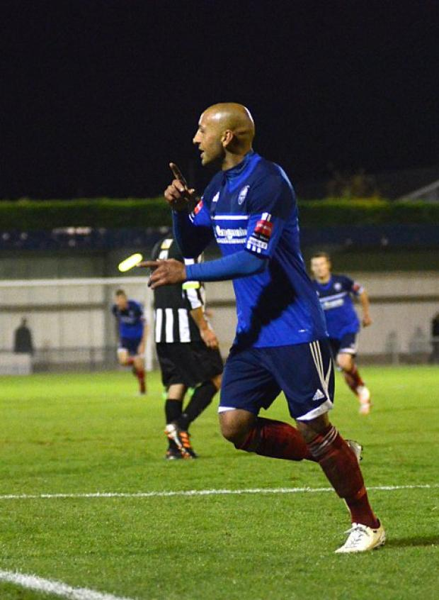 Going through: Met Police's Tyron Smith celebrates his late goal that confirmed the Blues their spot in the FA Cup fourth qualifying round