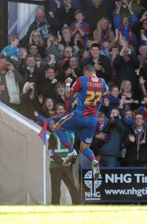 Flying high: Eagle Damien Delaney celebrates the third goal in the 4-3 win over Burnley