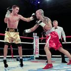 Hard hitter: Daws lays one on Finland's Piispanen during his successful bid for the European Union light-welterweight title          Gary Brind