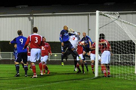 Up for it: Met Police midfielder Ty Smith gets up for a corner against Leiston on Tuesday night