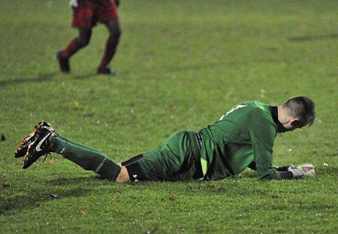 Down and out: Robins' keeper Ben Dudzinski contemplates life out of the FA Youth Cup after conceding Woking's third goal        SP71484