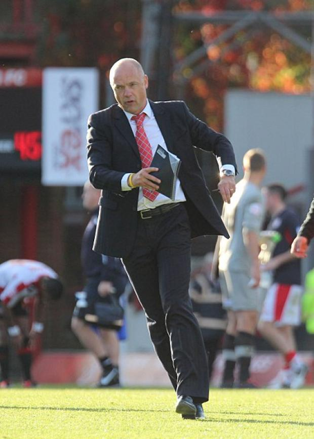 Staying put: Brentford boss Uwe Rosler will be staying a while longer in the Bees dugout