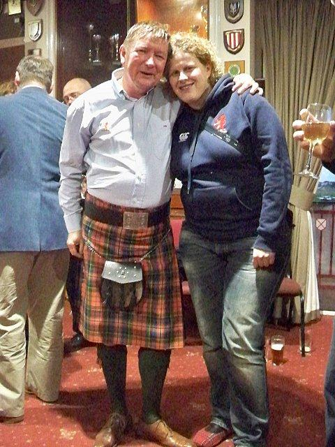 Partners in crime: Scottish fan Sandy Clark and his partner Jane Innes