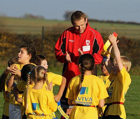 Sutton Guardian: Smooth talker: Jon Mills chats to Oxfordshire school children at the launch of London Welsh's community programme this week  Picture: Martin John