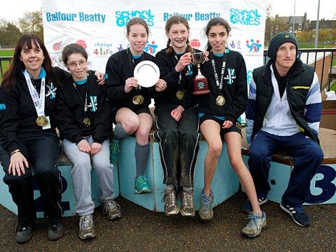 Medalists: The victorious girls' cross-country team with team manager Anne-Marie Osmonde (