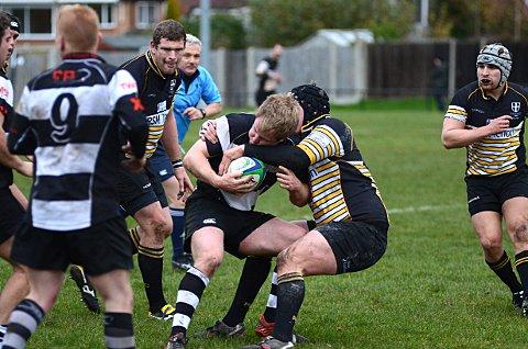 Hang on in there: Joe Ridgely holds onto possession despite the attentions of the Portsmouth pack    SP72030