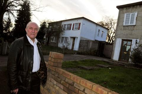 Tom Webster outside soon-to-be-demolished buildings in Duke of Edinburgh Road in The Wrythe