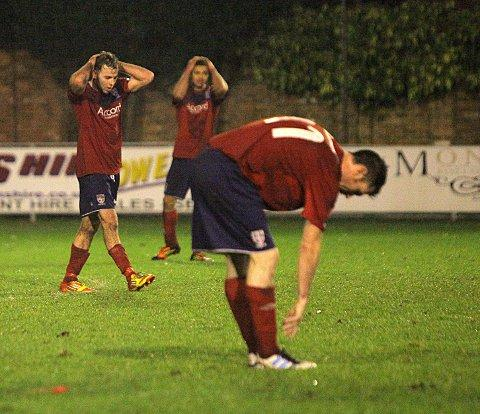 Stalemate: Hampton & Richmond Borough show their frustration at the final whistle of Saturday's 1-1 draw with Chelmsford City, which forced tonight's replay