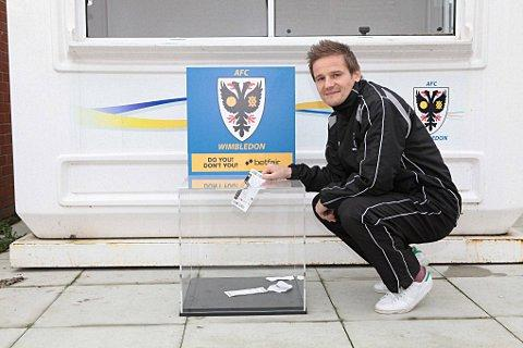 Sutton Guardian: Ticket amnesty: Dons boss Neal Ardley drops his ticket in the box, but of course he does not need one anyway