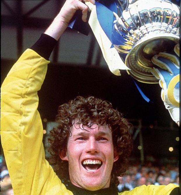 Happy days: Dave Beasant lifts the FA Cup for Wimbledon, a club he says is neither AFC Wimbledon or MK Dons    Picture: David McKnight