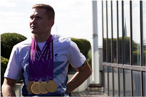 Golden boy: David Weir with his medals   Picture: Definitive Sports Management