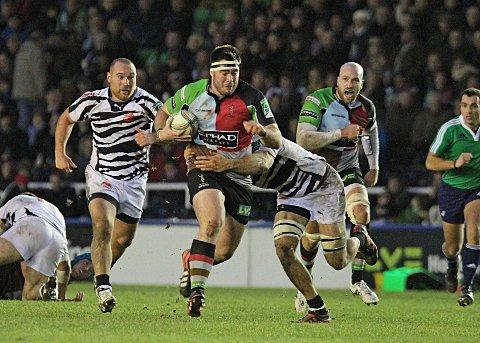 Stepping up: Quins prop Will Collier charges through the Zebre defence with George Robson in support