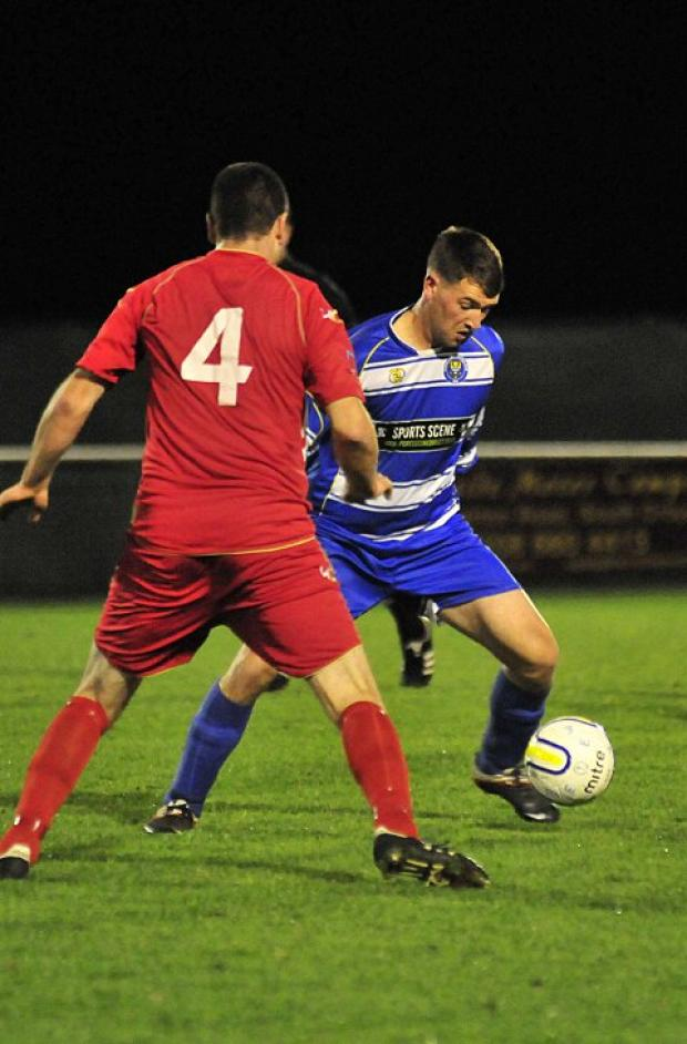 Burning desire for goals: Epsom's Robbie Burns set up the first two goals against Raynes Park, and then scored the third in a 6-1 win    SP71485