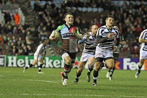 Dominant stuff: Quins scrum half Danny Care runs in his side's sixth try against Zebre