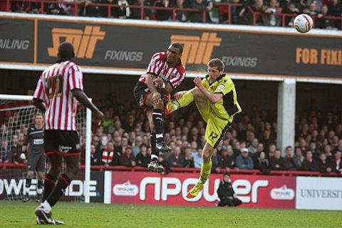 Waiting game: Brentford's Leon Legge in action against Sheffield United last season