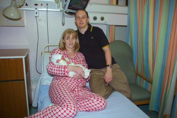 Sutton Guardian: Anita and Andrew Foulkes with baby Nathan who was born on the first day of 2013