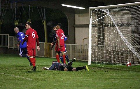 Sutton Guardian: Opener: Steve Noakes wheels away to celebrate opening the scoring on Wednesday