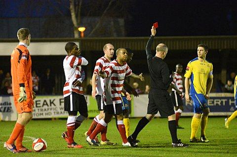 Seeing red: Kingstonian striker Wade Small protests Adam green's red card