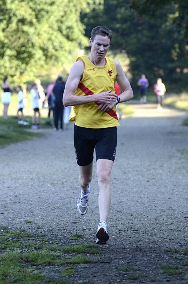 On the run: Phil Glynn in action for Wimbledon Hercules AC